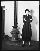 [Jane Fuller Standing Next to Wood Stove, Bedford, New York]