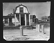 [Clapboard Beach House with Pilings in Driveway, Posssibly Canarsie, Brooklyn, New York?]