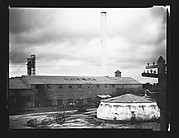 """[Buildings and Smokestack of """"Central El Pilar"""" Sugar Refinery, Cuba]"""