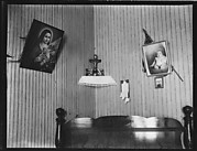 [Bedroom Interior with Religious and Family Pictures on Wall, Biloxi, Mississippi]