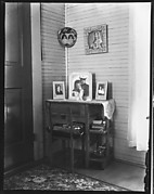 [Religious and Family Pictures on Desk and Wall in Corner, Biloxi, Mississippi]