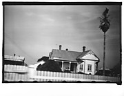 [Queen Anne House with Spindlework Porch and Gable Ornament, From Moving Automobile, Louisiana]