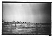 [Row of Wooden Houses in Field, From Moving Automobile, Louisiana]