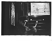 [Subway Passenger, New York City: Young Man in Billled Cap Reading on Times Square Shuttle]