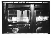 [Subway Passenger, New York City: Young Man Wearing Eyeglasses]