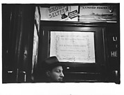 [Subway Passenger, New York City: Man in Hat Beneath Metropolitan Museum Concert Poster]