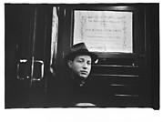 [Subway Passenger, New York City: Man in Hat Beneath Metropolitan Museum Concert Poster]