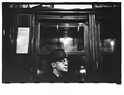 [Subway Passenger, New York City: Man in Hat and Eyeglasses]