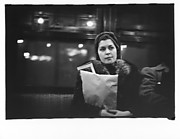 [Subway Passenger, New York City: Woman in Headscarf and Fur Collar Holding Parcel on Times Square Shuttle]