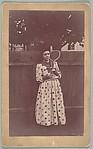 [Jessie Crane Evans Holding Tennis Racket, St. Louis, Missouri]