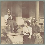 [Jessie Crane Evans and Walker Evans Jr. Seated Before Porch, with Unidentified Woman]