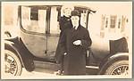 [Jane Beach Evans and Ralph Crane Standing Before Car]