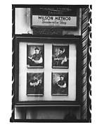 [Three 35mm Film Frames of Photographers' Studio Window Display, New York City?]