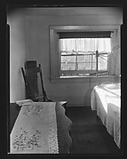 [Bedroom Interior with Table and Chair in Boarding House on Hudson Street, Residence of John Cheever, New York City]