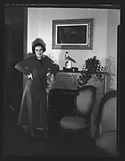 [Unidentified Woman Leaning on Fireplace Mantle]