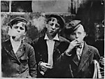 11:00 A.M. Monday, May 9th, 1910. Newsies at Skeeter&#39;s Branch, Jefferson near Franklin. They were all smoking. Location: St. Louis, Missouri.