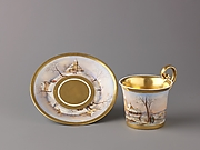 Cup and saucer with painted winter scenes