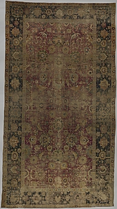 Indo-Persian carpet with vine scroll and palmette pattern