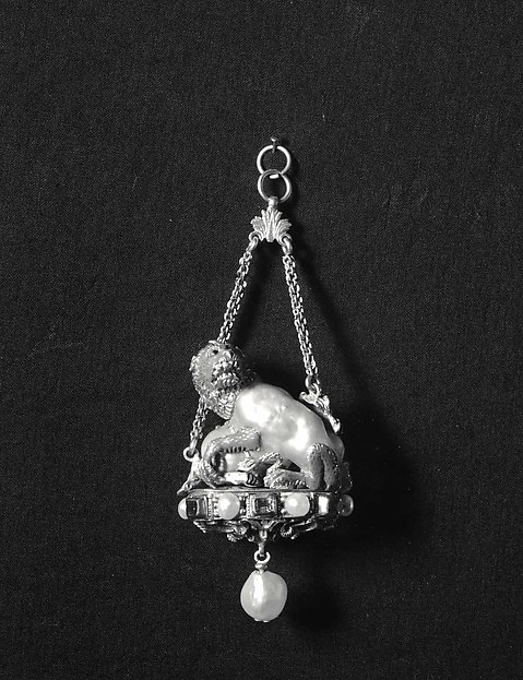 Pendant with a lion attacking a camel