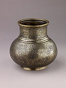 Vase with arabesque design, brass inlaid with silver