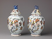 Covered Jar, polychrome floral decoration, handle on cover in shape of squirrel.