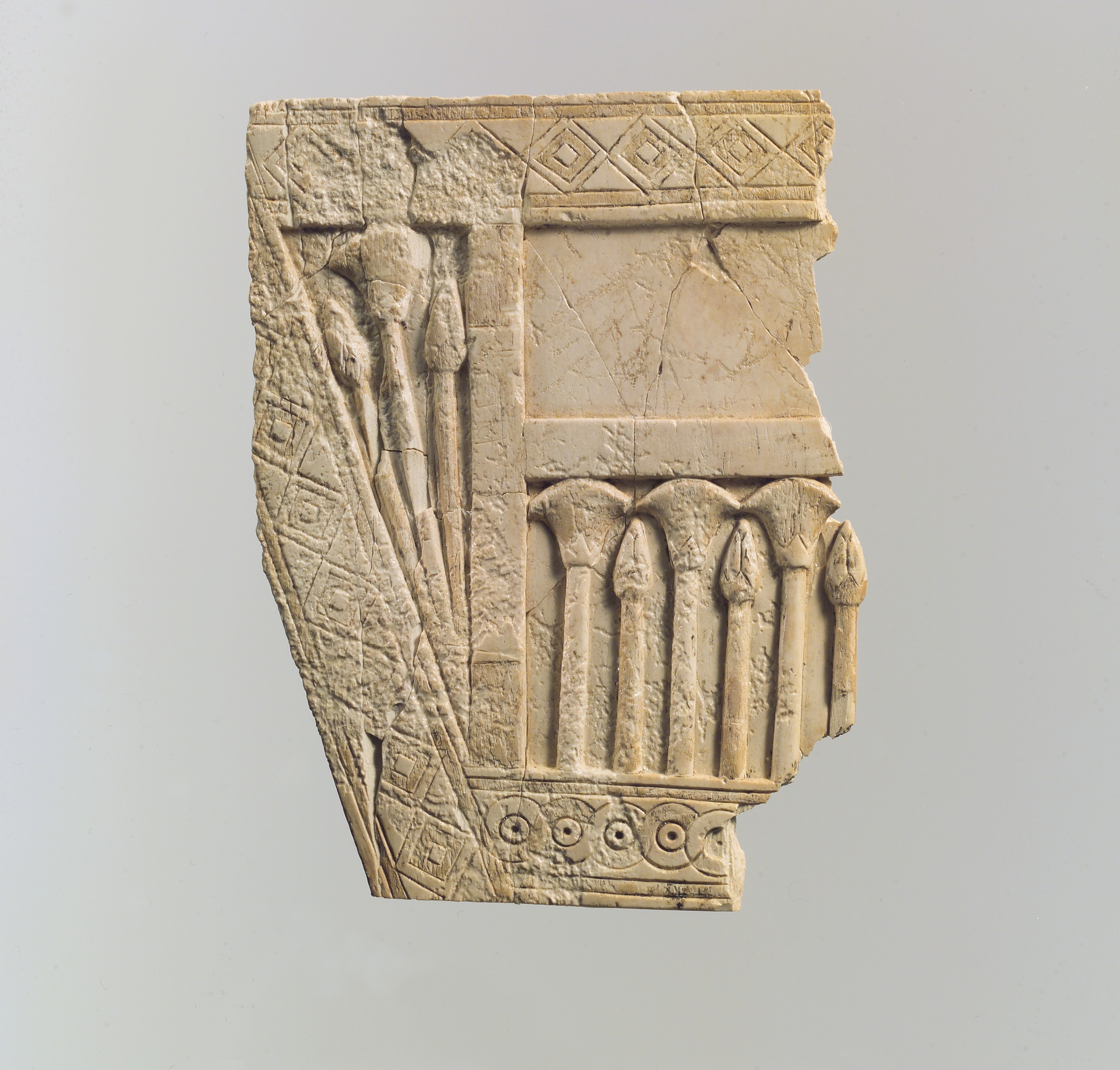Furniture plaque carved in relief with papyrus buds and flowers