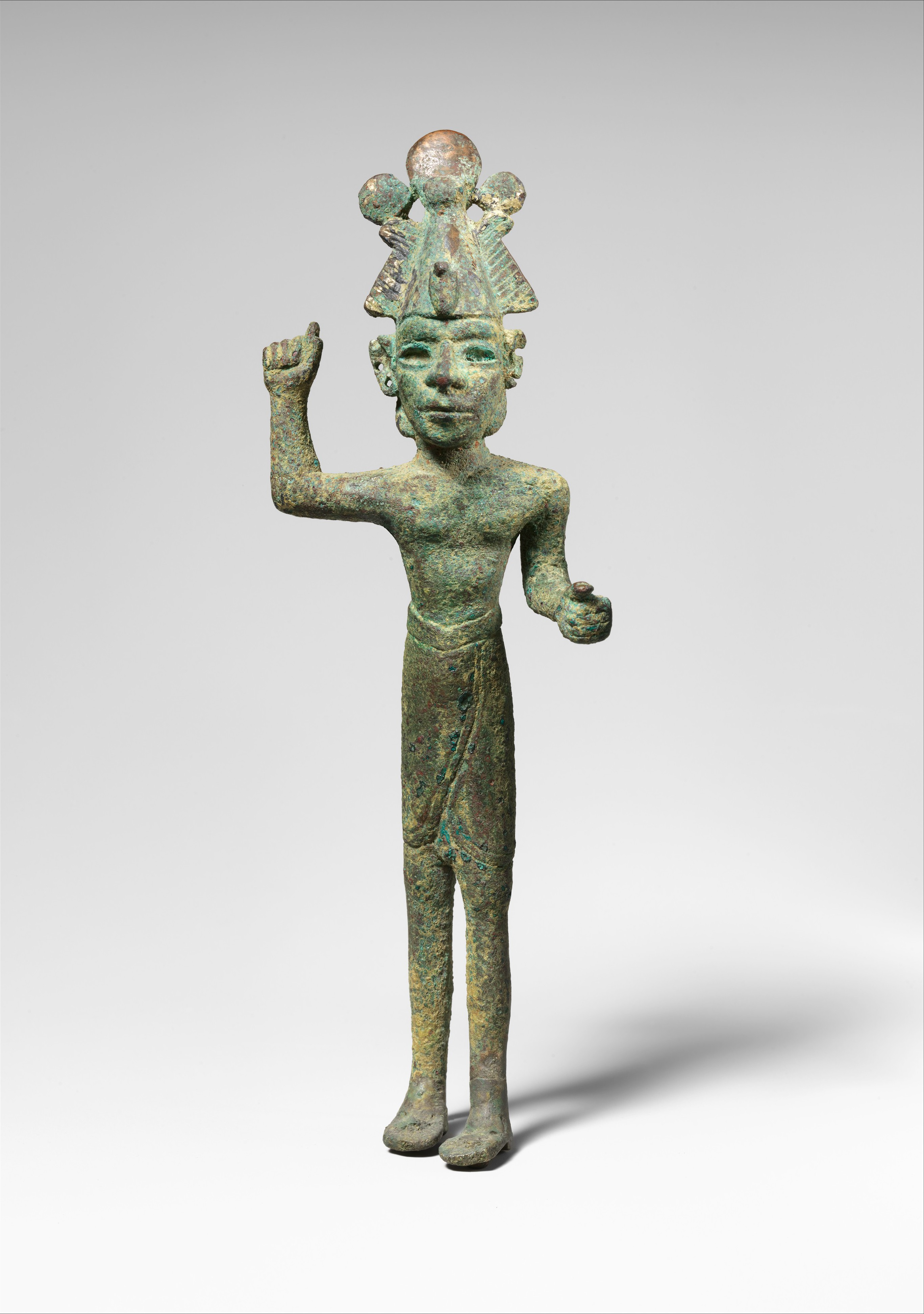 smiting god wearing an egyptian atef crown canaanite