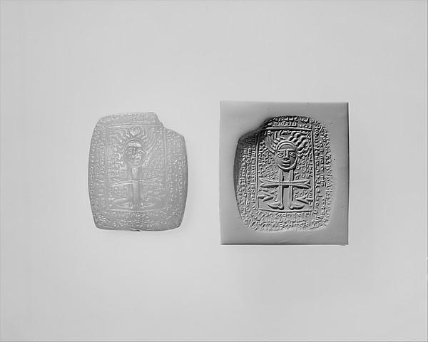 "<bdi class=""metadata-value"">Amulet inscribed in Middle Persian script 1.77 x 1.38 x 0.55 in. (4.5 x 3.51 x 1.4 cm)</bdi>"