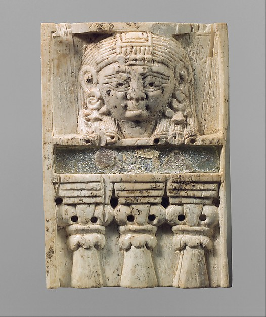 """Furniture plaque carved in relief with a """"woman at the window"""", Ivory, glass, Assyrian"""