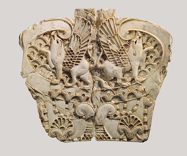 Cloisonné furniture plaque with two griffins in a floral landscape, Ivory, Assyrian