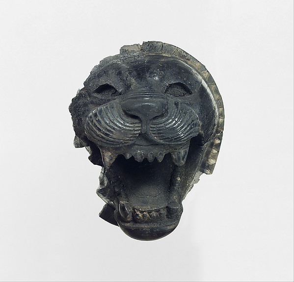 Furniture element carved in the round with the head of a roaring lion, Ivory, Assyrian