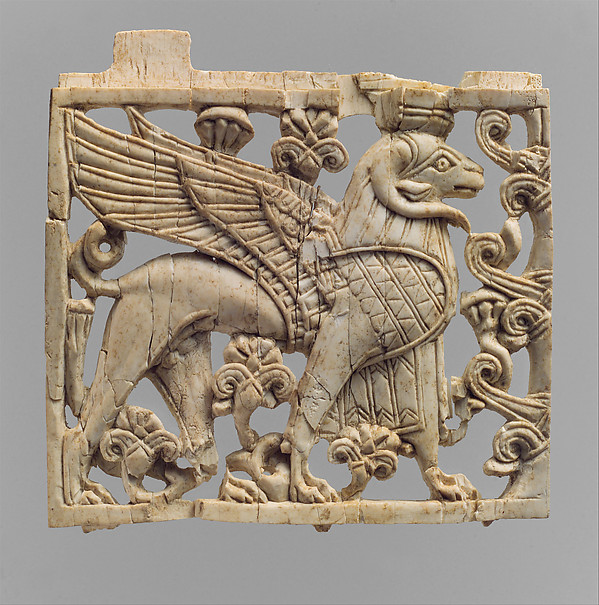 Openwork furniture plaque with a striding, ram-headed sphinx, Ivory, Assyrian