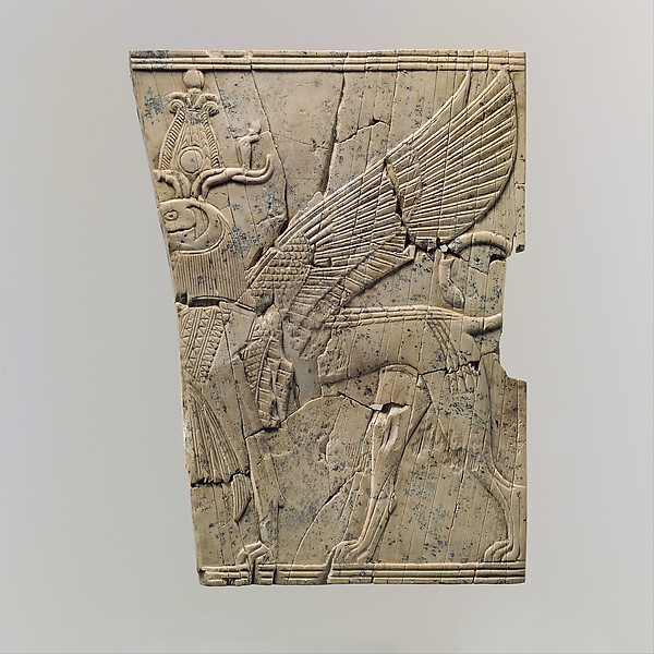 Furniture plaque carved in relief with a winged, falcon-headed sphinx, Ivory, Assyrian