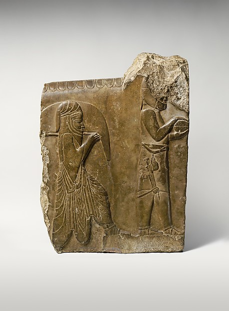 Relief: two servants bearing food and drink, Limestone, Achaemenid