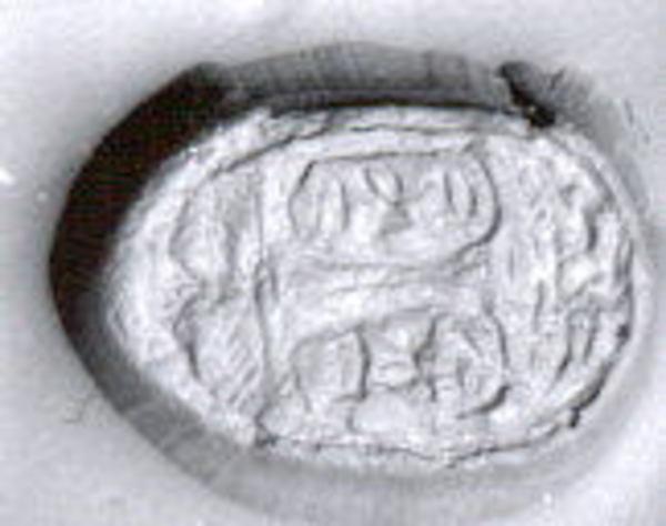 Scarab seal in copper mount, Steatite, white; copper alloy mount