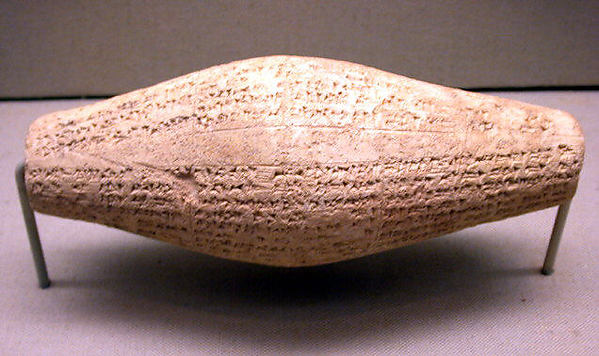 Cuneiform cylinder with inscription of Nebuchadnezzar II, describing the rebuilding of Ebabbar, the temple of the sun-god Shamash at Sippar, Clay, Babylonian