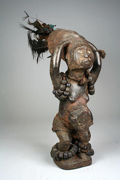 Power Figure: Female (Nkisi), Wood, encrustation, feathers, beads, cloth, ivory, glass, leather, Kongo peoples, Sundi group
