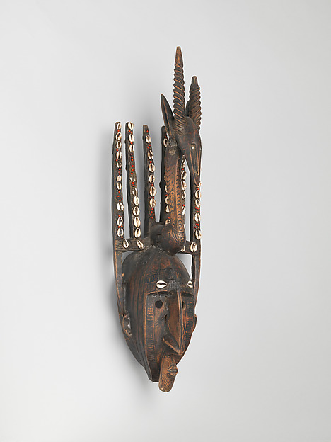 Mask: Antelope Figure (Ntomo), Wood, pigment, cowrie shells, seeds, latex, metal, Bamana peoples