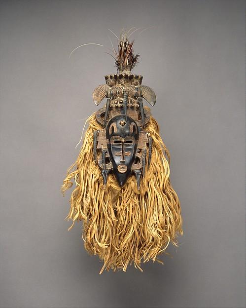 Face Mask (Kpeliye'e), Wood, horns, raffia fiber, cotton cloth, feather, metal, sacrificial material, Senufo peoples
