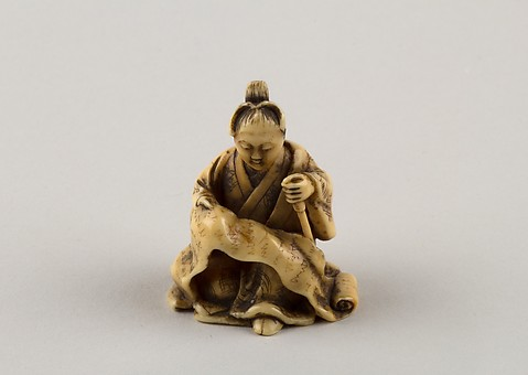 Netsuke of Woman Reading from a Scroll