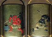 Case (Inrō) with Design of an Onî (Demon) Carrying a Temple Bell and Paper Lantern over His Shoulder (obverse); Onî Carrying Fish Head Stuck on a Pole and Holly Branch (reverse), Lacquer, kinji, gold, red, silver and black hiramakie, takamakie; Interior: silver lacquer and fundame, Japan