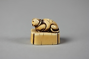 Netsuke of Cat on a Seal-Shaped Base, Ivory; slight brown stain, Japan