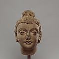 Head of Buddha, Stucco with traces of paint, Pakistan (ancient region of Gandhara)