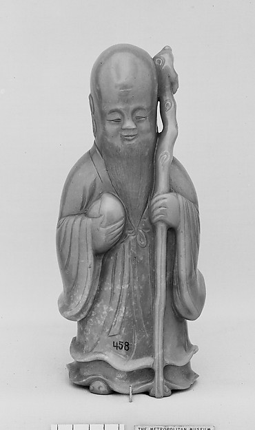 Figure of Shou Lao, Longevity Deity, Nephrite, yellow with a greenish tint and spots of very light brown, China