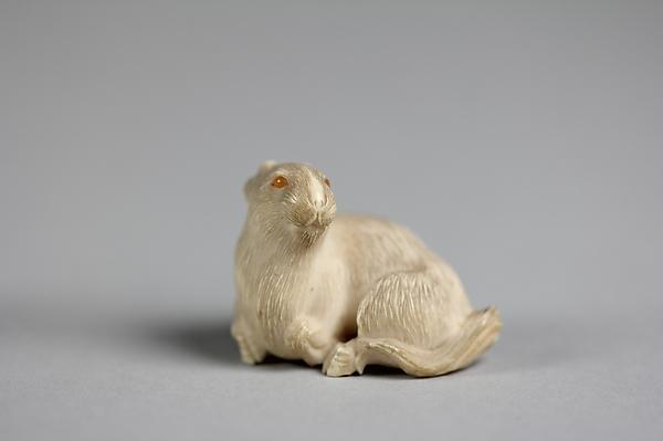 Netsuke of Goat, Ivory, glass eyes, Japan