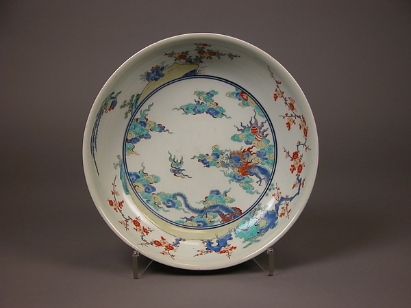 Shallow Bowl with Design of Dragon amid Waves, Phoenix, and Flowers, Porcelain with overglaze enamels (Hizen ware, Arita region, Kakiemon style), Japan