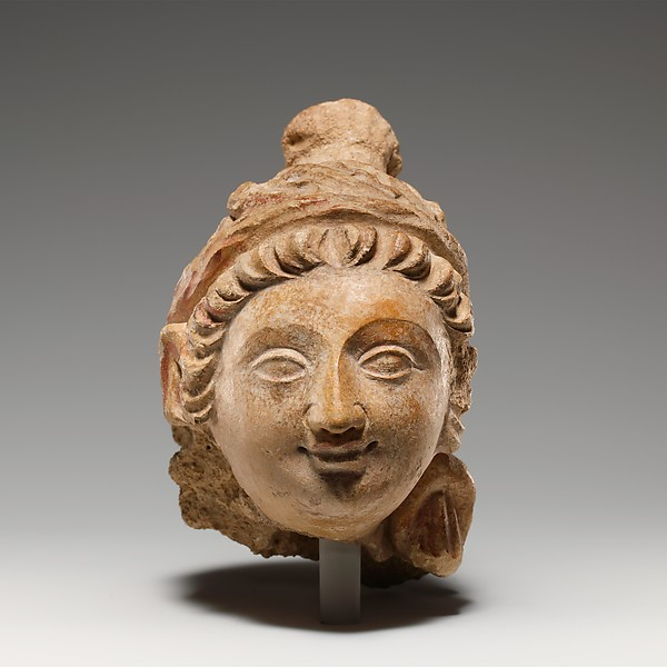 Head of a Female Figure, Stucco with traces of color, Pakistan (ancient region of Gandhara)