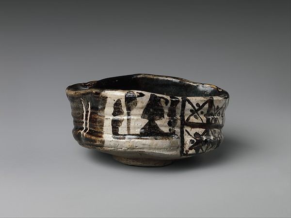 Clog-Shaped Teabowl with Design of Plum Blossoms and Geometric Patterns, Stoneware with iron-black glaze (Mino ware, black Oribe type), Japan