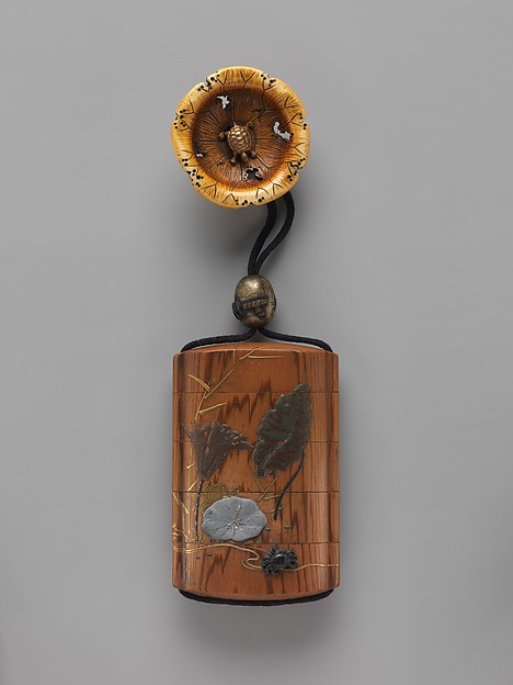 Case (Inrō) with Lotus and Crab (obverse); Lotus and Tadpole (reverse), Case: powdered gold (maki-e), lead foil, and carved metal on black lacquer; Fastener (ojime): metal with design of tadpoles in a stream; Toggle (netsuke): ivory carved in the shape of a lotus leaf and turtle, Japan