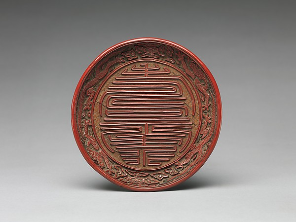 Dish with the character for longevity (shou), Carved red and yellow lacquer, China